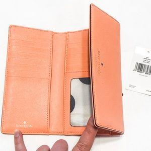 Kate Spade orange trifold wallet